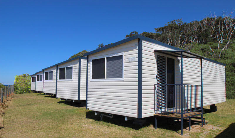 Transportable cabins located along the coastline of NSW at a caravan home